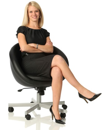 Confident business woman sitting in office chair