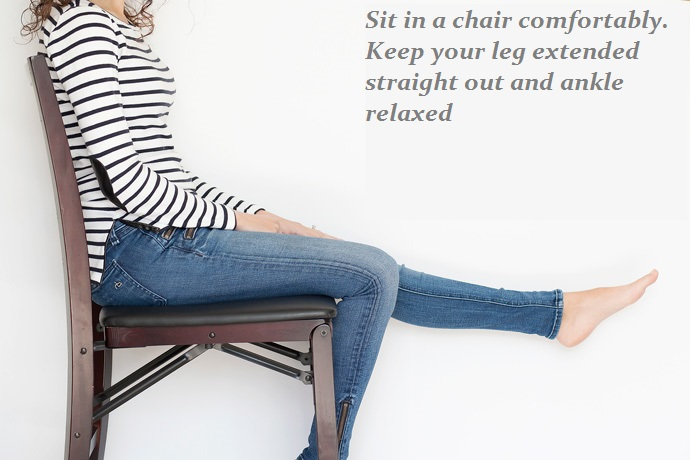 Sitting in a chair to measure natural heel height